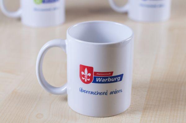 """Tasse mit Logo der Wirtschaftsförderung und Stadtmarketing """"Hansestadt Warburg"""""""